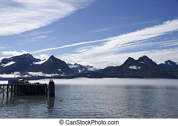 Harbor in Valdez - Pier in Valdez Harbor with mountain ...