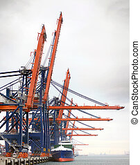 Harbor - Industrial harbor with large cranes, unloading ...