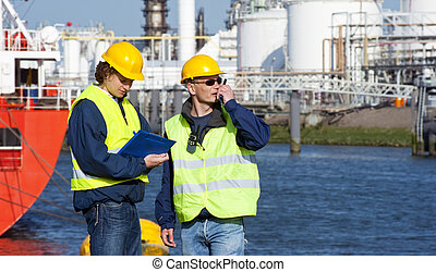 Harbor inspection - Two dockers during a routine inspection ...