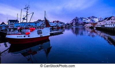 harbor of Henningsvaer on the Lofoten in a timelapse movie