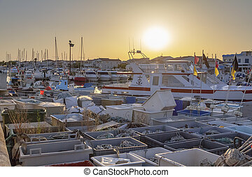harbor of Saintes-Maries-de-la-Mer, the capital of the camargue in the south of France at evening time