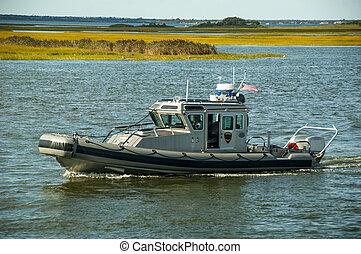 Harbor Patrol - A harbor police boat patrols the waterways