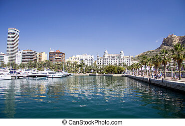 The Alicante Marina with boats and yachts on the left and a pedestrian way on the right