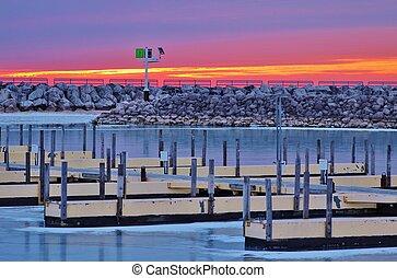 Harbor Sunrise - Sunrise over a frozen Great Lakes harbor. ...