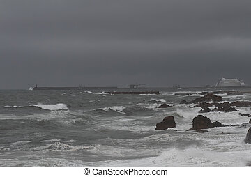 Harbor wall in a stormy day