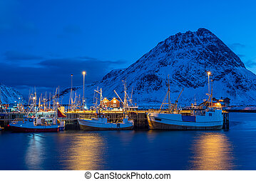 Harbor with fishing boats at twilight in winter season, Lofoten islands, Norway