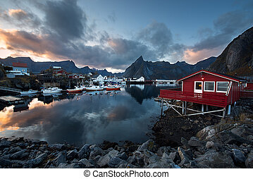 Harbor with fishing boats in traditional fishing village of...