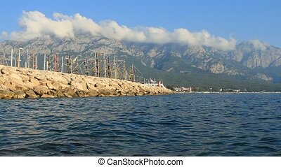 Harbor with yachts and ships on the coast of Kemer, Turkey