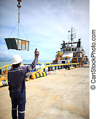 Harbor worker - watching the loadin