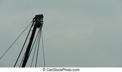 Harbour crane with gulls flying