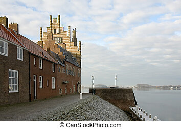 Harbour Entrance - Buildings on a harbour wall, the ...