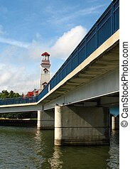 The Sung Harbour lighthouse in Port Credit, Mississauga, Ontario, Canada with pedestrian bridge in foreground.