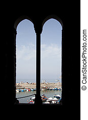 harbour of vernazza seen through church window