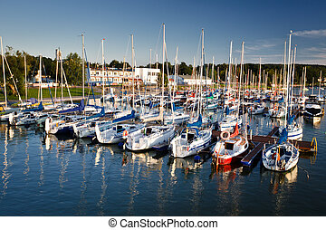 Harbour with boats in the lake at summer