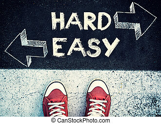 Hard and easy dilemma - Student standing above the hard and...