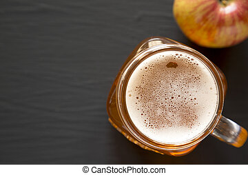 Hard Apple Cider Ale in a Glass Jar Mug, top view. Flat lay, overhead, from above. Copy space.