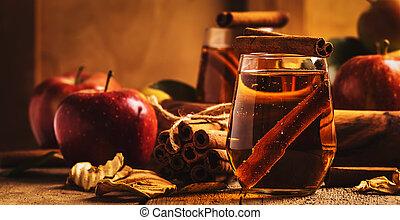 Hard Apple Cider Ale Ready to Drink. Cocktail with cinnamon, vintage wooden background