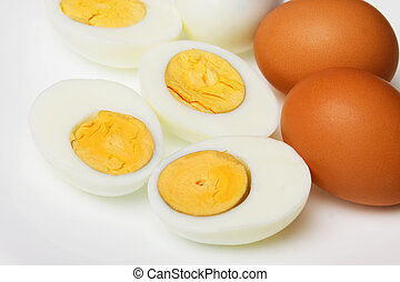 Hard boiled chicken eggs over white background, not isolated