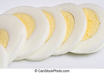 hard boiled eggs sliced ready to top a great salad