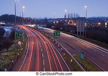 brake lights of cars on fast road as they approach road construction in England, UK.