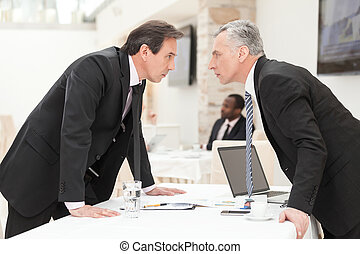 Two businessmen are trying to come to an agreement.