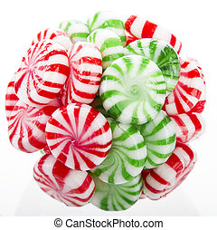 hard red, green and white candy mints stuck in a ball