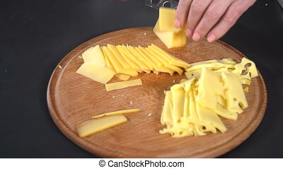 Hard cheese cut with a knife. slow motion