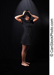 hard day - afro-american woman against black background