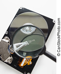 Hard disc of computer through magnifying glass