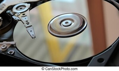 hard disk drive - hard disk writing data with its head.
