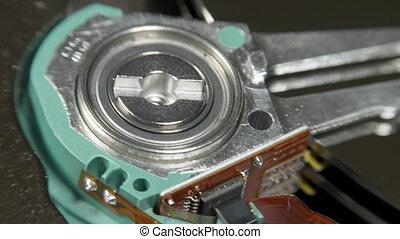 Hard disk drive on the rotation table, macro shot.