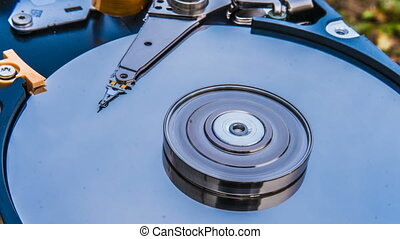 Hard disk drive with reflected in it the time-lapse of...