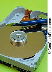 Hard Disk Pen - Close-up view of computer hard disk drive...