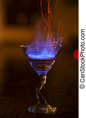 Hard drink with fire and sparks