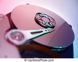 Hard Drive - Close up of a computer hard drive internal. Red...