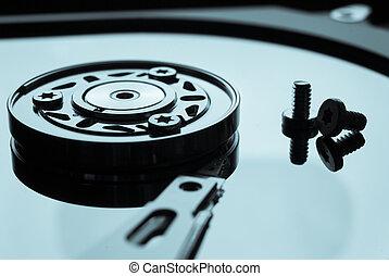 Hard drive or hard disc on black reflex background