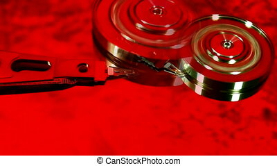 Hard drive platter colorized showing read write head with...