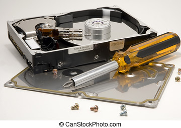 Hard drive - A disassembled hard drive with a screwdriver.