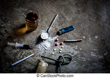 Hard drugs and alcohol on dark stone table. Top view