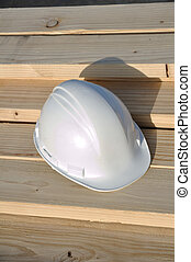 Hard Hat on Lumber