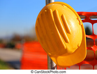 hard hat on the road construction site during road works and...