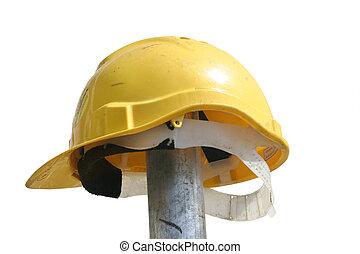 Hard hat resting on a pole - hard hat