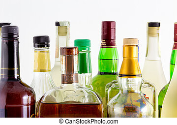 Hard liquor bottles against a white background.