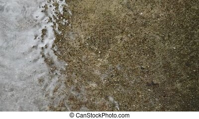 hard rain drop and splashing on cement ground in park