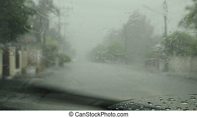 hard rain falling through car windshield and wipe out
