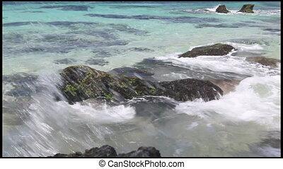 Hard waves over seaside rocks