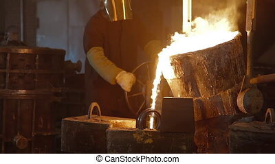 Hard work in a foundry. Metal smelting furnace in steel mill...