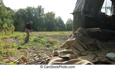 Hard work on the farm. - Elderly man mowing grass. Hard work...