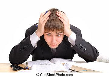 hard work - shocked teenager studying hard for the exam
