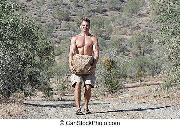 Hard work - Strong muscular shirtless Caucasian man...